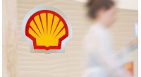 shell-logo-with-employee-climbing-steps-in-the-background